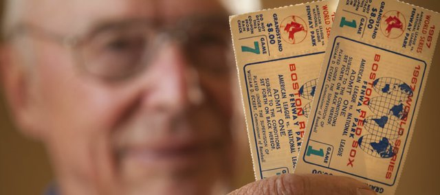 Lawrence resident Joe Reitz displays two tickets, one from game 1 of the 1967 World Series between the Boston Red Sox and St. Louis Cardinals, and another from game 7, both valued at $8 apiece.