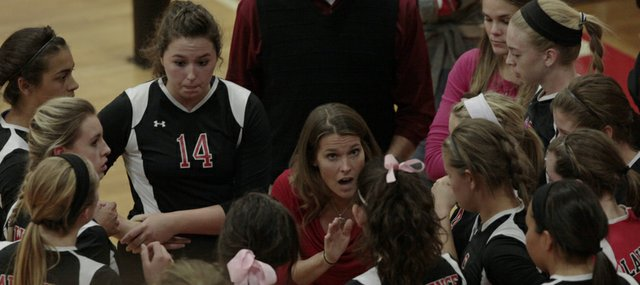 Lawrence High volleyball coach Stephanie Magnuson talks to her team during a close match against Free State Thursday night at LHS. The Lions won in four sets.