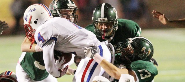 Free State's defense swarms on Olathe North quarterback Willams Rayquan on Friday, Oct. 21, 2011 at FSHS.