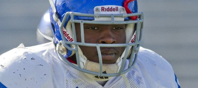 Kevin Anderson/Journal-World Photo.Kansas linebacker Collin Garrett (57) at practice Wednesday, Oct. 19, 2011.