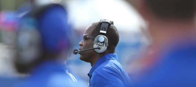 Kansas head coach Turner Gill watches the dismantling of his football team from the sideline during the third quarter on Saturday, Oct. 22, 2011 at Kivisto Field.