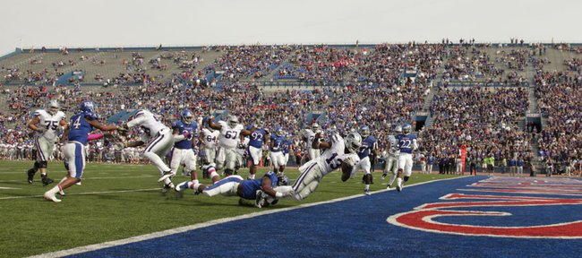 Kansas State quarterback Sammuel Lamur falls into the endzone for a touchdown during the fourth quarter on Saturday, Oct. 22, 2011 at Kivisto Field.