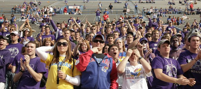A handful of remaining Kansas fans watch the final minutes of play from the Jayhawk student section as it is overrun with Kansas State fans on Saturday, Oct. 22, 2011 at Kivisto Field.