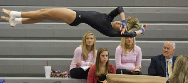 Free State gymnast Haley Johnson tumbles over the vault as the judges watch during the 2011 Kansas 6A State Championship Saturday, Oct 22, 2011 at Shawnee Mission Northwest High.