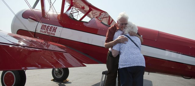 Bob MacLeay gets a hug from his wife, Marge, after he landed safely in a 1942 Stearman biplane. The World War II veteran got the chance to fly in the same type of plane used to train pilots in the 1930s and '40s.  The flight, made possible through Ageless Aviation Dreams, took off from Lawrence Municipal Airport and lasted about 20 minutes.