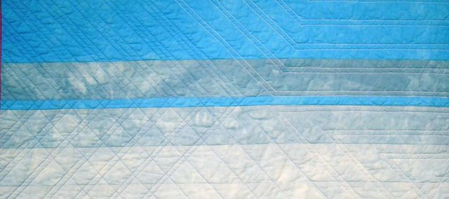 """This, one of four quilts by Kim Eichler-Messmer, will be on display at Wonder Fair as part of """"Hibernation"""" during the October 2011 Final Friday. Eichler-Messmer models her quilts after photos she takes of various types of light."""