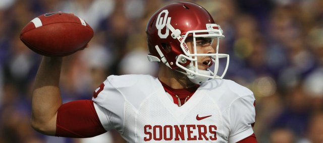 Oklahoma quarterback Landry Jones (12) passes during the first half against Kansas State Saturday, Oct. 29, 2011, in Manhattan, Kan.