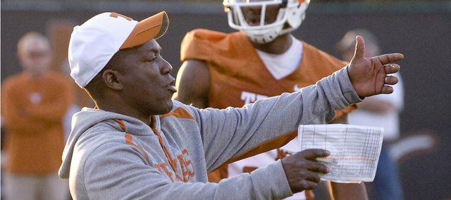 Darrell Wyatt coaches a Texas practice. Wyatt was on the sidelines last season for Kansas University.