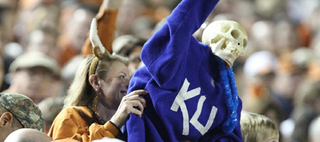 In the spirit of Halloween, a Texas fan hoists a skeletal effigy of the Jayhawks during the fourth quarter on Saturday, Oct. 29, 2011 at Darrell K Royal-Texas Memorial Stadium.