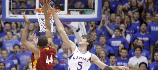 Kansas center Jeff Withey gets a hand Pittsburg State forward JaVon McGee's shot during the first half Tuesday, Nov. 1, 2011 at Allen Fieldhouse.