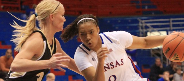 Kansas freshman freshman Asia Boyd dribbles against Emporia State's Kayla Krueger in the second half Wednesday, Nov. 2, 2011 at Allen Fieldhouse.
