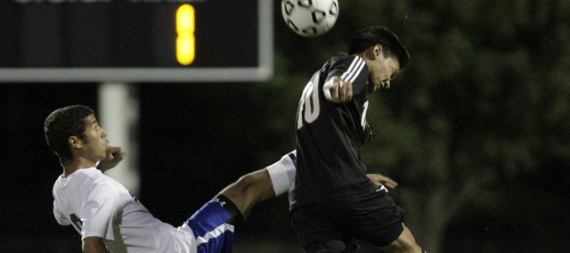 Lawrence High's Robert Lyan, right, competes for the ball with Olathe South's Adrian Thomas in the 6A boys state soccer quarterfinals Tuesday, Nov. 1, 2011 at ODAC.