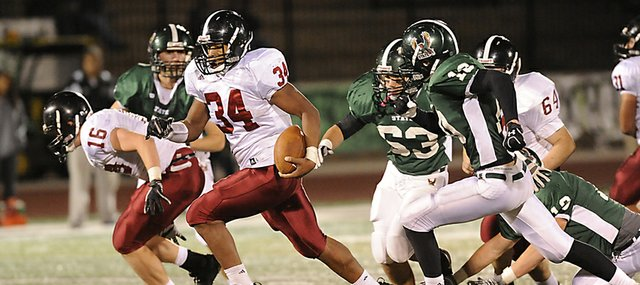 Lawrence High running back-turned-quarterback Tyrone Jenkins breaks loose against Free State on Friday, Oct. 28, 2011.
