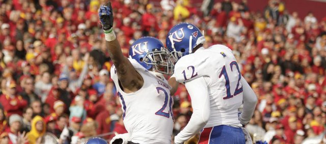 Kansas receiver D.J. Beshears (20) celebrates his touchdown with Christian Matthews (12) against Iowa State during the first quarter on Saturday, Nov. 5, 2011 at Jack Trice Stadium in Ames, Iowa.