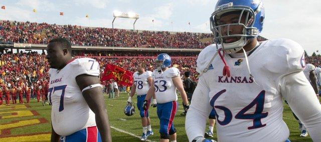 Kansas offensive lineman Jeremiah Hatch (77) and defensive tackle Randall Dent (64) leave the field with blank stares following the Jayhawks' 13-10 loss to Iowa State on Saturday, Nov. 5, 2011 at Jack Trice Stadium in Ames, Iowa.
