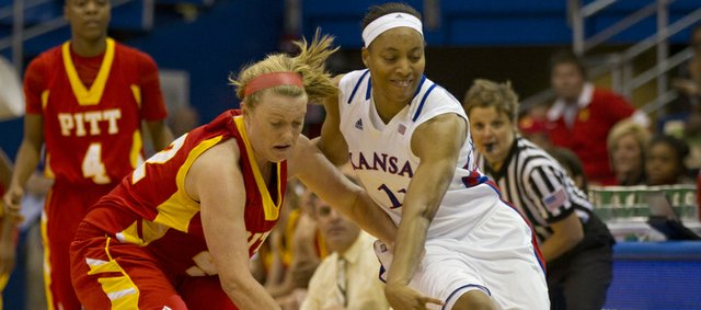 Kansas' Aishah Sutherland, right, knocks the ball away from Pitt State's Lizzy Jeronimus during Kansas' final exhibition game against Pittsburg State Sunday, Nov. 6, 2011 at Allen Fieldhouse. The Jayhawks, who won 68-43, open the season at home against Western Michigan on Nov. 13.