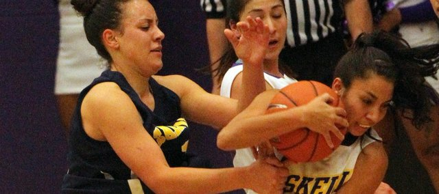 Haskell senior Nataska Rouse strips the ball from St.Mary's' Kendra Mattox on Tuesday, Nov. 8, 2011 at Haskell Indian Nations University.