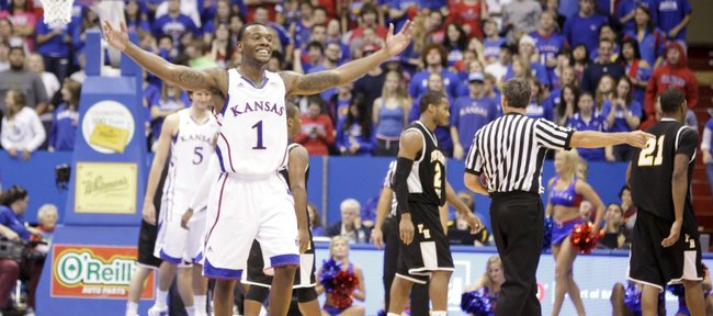 Kansas guard Naadir Tharpe raises up the Fieldhouse during a run by the Jayhawks against Fort Hays State during the second half on Tuesday, Nov. 8, 2011 at Allen Fieldhouse.
