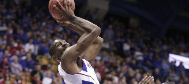 Kansas forward Justin Wesley goes up to the bucket between Fort Hays State defenders Karron Mckenzie (2) and Lance Russell (21) during the second half on Tuesday, Nov. 8, 2011 at Allen Fieldhouse.