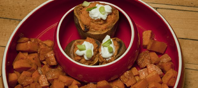 In the small bowl: Twice Baked Chipotle-Lime Sweet Potatoes by Megan Stuke. In the larger bowl: Spicy Ginger Holiday Sweet Potatoes by Sarah Henning.