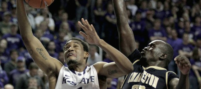 Kansas State guard Shane Southwell (1) gets past Charleston Southern forward Mathiang Muo (23) to put up a shot during the second half Friday, Nov. 11, 2011, in Manhattan, Kan. Kansas State won the game, 72-67.