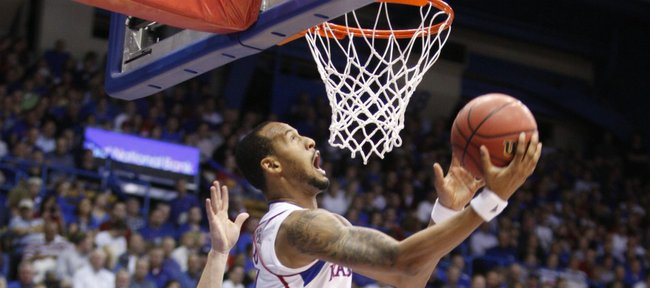 Kansas guard Travis Releford is fouled as he goes up for a reverse layup against Towson during the first half on Friday, Nov. 11, 2011 at Allen Fieldhouse.