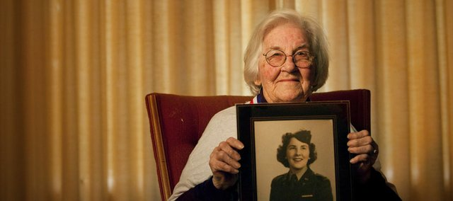 Lawrence resident Edna Poole, 93, is pictured with a photograph of herself from her years serving as a nurse in World War II. Poole, who recently returned from an Honor Flight to Washington D.C. to visit the World War II Memorial and also Arlington National Cemetery, where her late husband Rufus Poole, also a World War II veteran is interred.