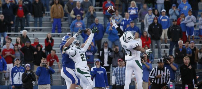 Kansas tight end Tim Biere can't come down with a two-point conversion attempt as he is boxed out by Baylor defenders Joe Williams (22) and Mike Hicks (17) during overtime on Saturday, Nov. 12, 2011 at Kivisto Field.
