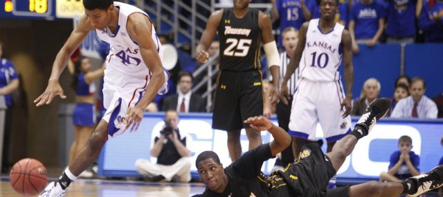 Kansas forward Kevin Young comes away with a steal from Towson forward Enrique Gumbs during the first half on Friday, Nov. 11, 2011 at Allen Fieldhouse.