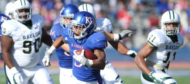 Kansas running back Darrian Miller races up the field for a first down against Baylor during the first quarter on Saturday, Nov. 12, 2011 at Kivisto Field. The run helped put the Jayhawks in field goal range.