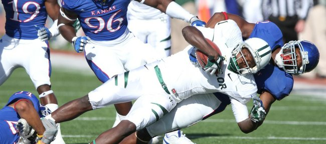 Kansas linebacker Steven Johnson drags down Baylor receiver Kendall Wright with the help of safety Bradley McDougald, left, during the first quarter on Saturday, Nov. 12, 2011 at Kivisto Field.