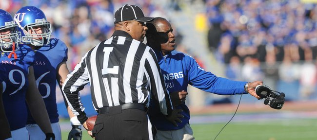 Kansas head football coach Turner Gill speaks with an official as KU took on Baylor on Saturday, Nov. 12, 2011 at Memorial Stadium.