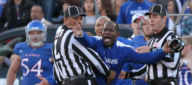 Kansas head coach Turner Gill pleads for an interference call against Baylor after a pass to KU receiver JaCorey Shepherd during KU's last drive of regulation Saturday, Nov. 12, 2011 at Kivisto Field.