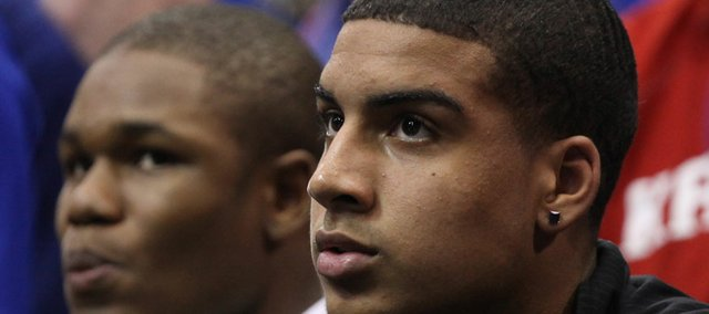 Kansas recruit Landen Lucas watches the action during the second half on Friday, Nov. 11, 2011 at Allen Fieldhouse.