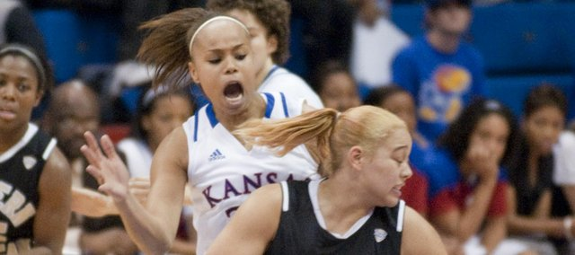 Tania Jackson (33) left, defends in KU's game against Western Michigan University at KU Sunday, Nov. 13, 2011.