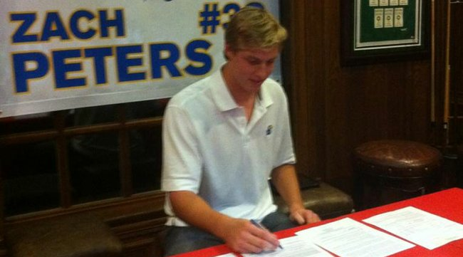 Zach Peters officially signs with KU at his house in Plano, Texas.