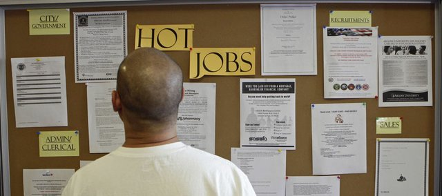 A job seeker checks for new job postings Thursday at Glendale Workforce Services Center in Glendale, Calif., in this 2010 file photo. It will take Kansas three more years to fully recover the jobs lost in the Great Recession that started in 2008, according to a recent national economic analysis.