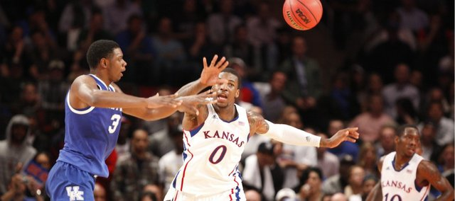 Kansas forward Thomas Robinson defends as Kentucky forward Terrance Jones passes during the first half on Tuesday, Nov. 15, 2011 at Madison Square Garden in New York.