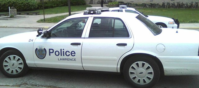 In this 2010 file photo, a Lawrence Police Department patrol car responds to a call at Kansas University's McCollum Hall. There will be more patrol cars on the streets next week as Lawrence participates in the Kansas Thanksgiving Traffic Enforcement Campaign.