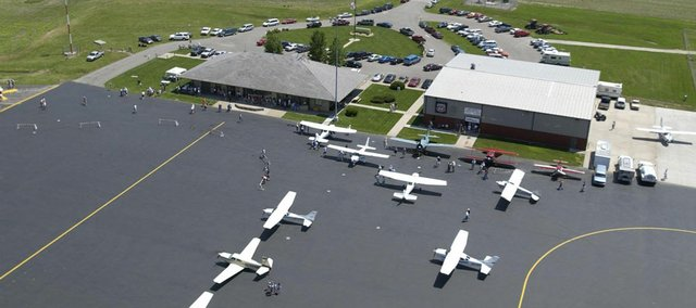 In this 2009 file photo of Lawrence Municipal Airport, several vintage and modern aircraft are on display. Local businessman William McCauley recently filed a complaint against the city with the Federal Aviation Administration, because he wants to run a business allowing parachutists to land at the airport.