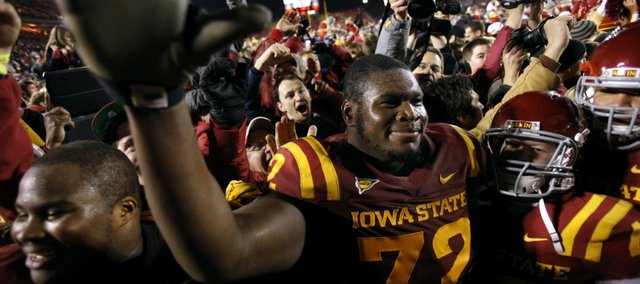 Iowa State offensive linesman Kelechi Osemele reacts with fans after his team's 37-31 in double overtime win over Oklahoma State on Friday, Nov. 18, 2011, in Ames, Iowa.