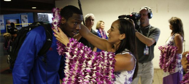 Kansas guard Tyshawn Taylor leans forward to receive a lei as a welcoming gesture upon the Jayhawks' arrival at the Kahului Airport on Friday, Nov. 18, 2011 in Maui.