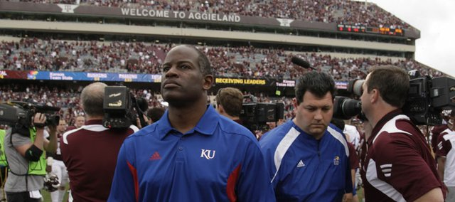 Kansas head coach Turner Gill walks off the field after falling to Texas A&M, 61-7, Saturday, Nov. 19, 2011 at Kyle Stadium in College Station, Texas.