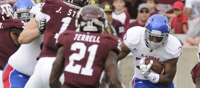 Kansas running back James Sims carries the ball in the first half against Texas A&M on Saturday, Nov. 19, 2011 at Kyle Stadium in College Station, Texas.