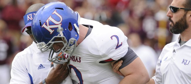 Kansas quarterback Jordan Webb is helped off the field after a big hit by the Texas A&M defense Saturday, Nov. 19, 2011 at Kyle Stadium in College Station, Texas.