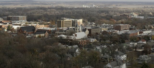 Sunshine falls on downtown Lawrence and the river valley to the northeast as viewed Saturday from The Oread, 1200 Oread Ave. Downtowns tallest building include the Hobbs Taylor Lofts at 730 N.H., rising at far left, the U.S. Bank tower at Ninth and Massachusetts streets, and the new seven-story apartment/retail/office project at Ninth and New Hampshire streets at center right. As downtown development brings taller buildings, city commissioners are dealing with the issue of how these buildings produce long shadows and what it means for the surrounding neighborhoods.