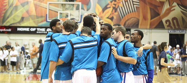 The Kansas Jayhawks come together in a huddle wearing special warmups for the Maui Invitational before tipping off against Georgetown on Monday, Nov. 21, 2011 at the Lahaina Civic Center.