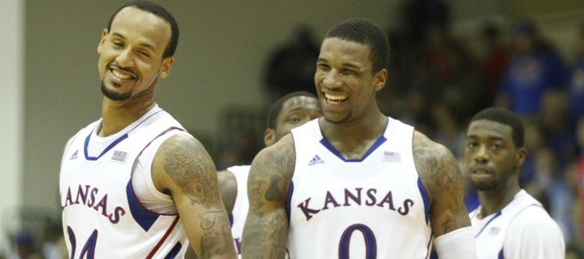 Kansas players Thomas Robinson (0) and Travis Releford (24) have a laugh during the second half on Monday, Nov. 21, 2011 at the Lahaina Civic Center. At right is KU guard Elijah Johnson.