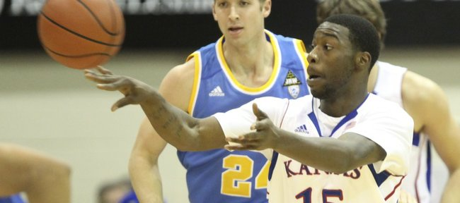 Kansas guard Elijah Johnson pushes the ball up the court against UCLA during the first half Tuesday, Nov. 22, 2011 at the Lahaina Civic Center.