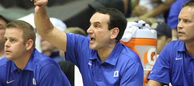 Duke head coach Mike Krzyzewski calls a play from the bench during the second half against Michigan on Tuesday, Nov. 22, 2011 at the Lahaina Civic Center.